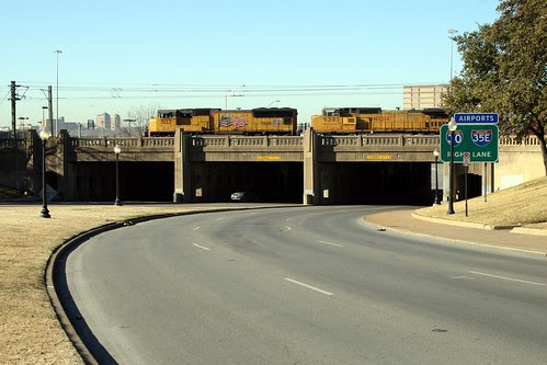triple underpass with train running on overpass