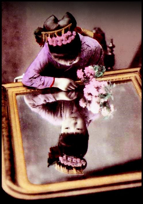 A YOUNG MAIKO IN A MIRROR