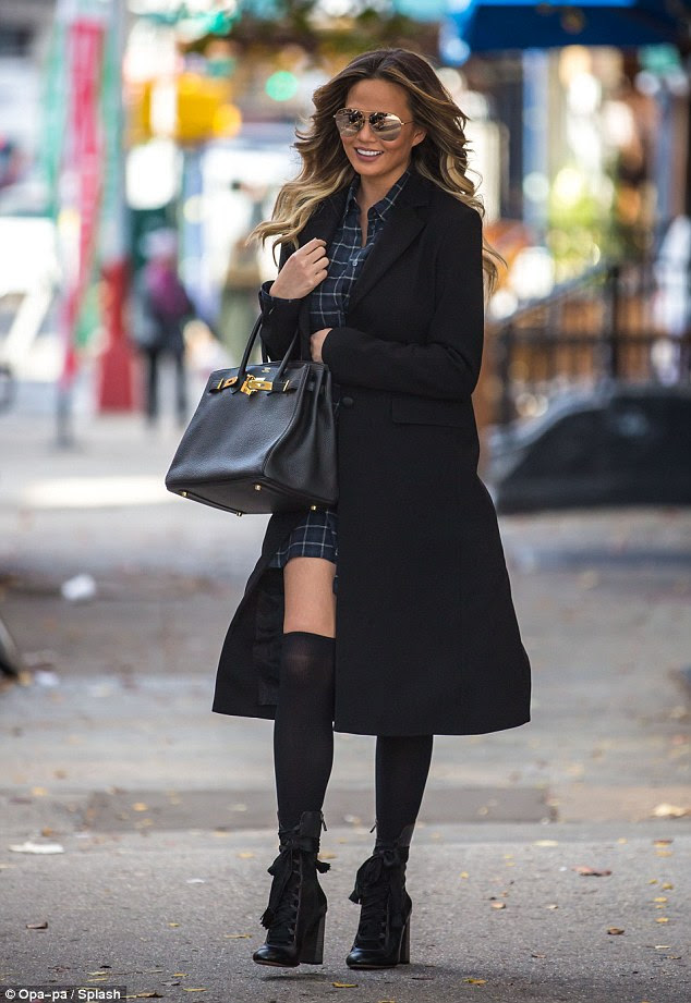 Stylish: The now 30-year-old Lip Sync Battle co-host added a stylish coat, lace-up boots and a chic handbag to the ensemble