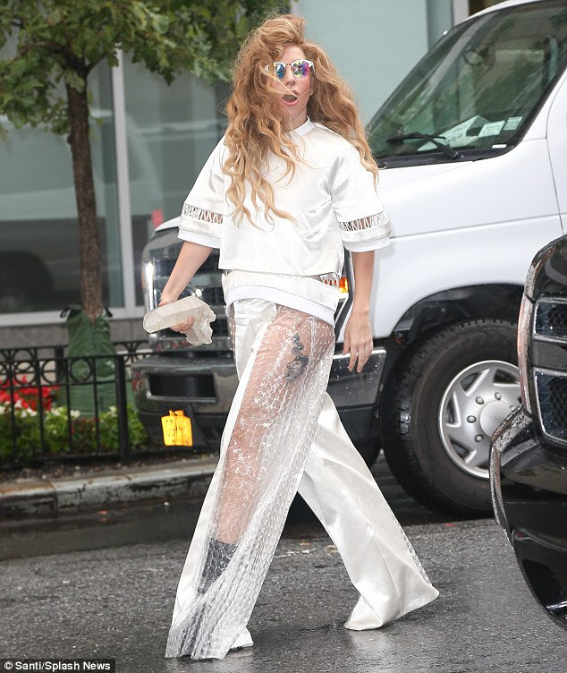 Leggy lady: Lady Gaga's thigh tattoo was on full display through the sheer fabric of her silver suit in New York on Thursday