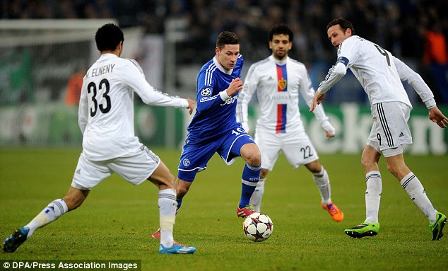Target: Arsenal are closing in on a deal for £37million-rated Schalke forward Julian Draxler (centre)