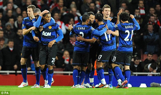 United front: Sir Alex Ferguson's players celebrate Valencia's goal at the Emirates Stadium