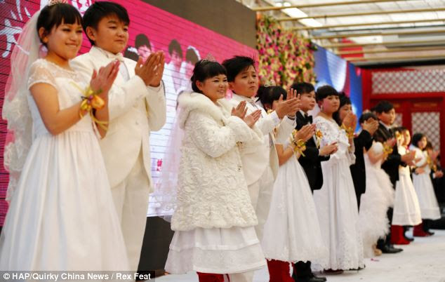Line-up: The pairs of midgets clap their hands in unison at the end of their group wedding