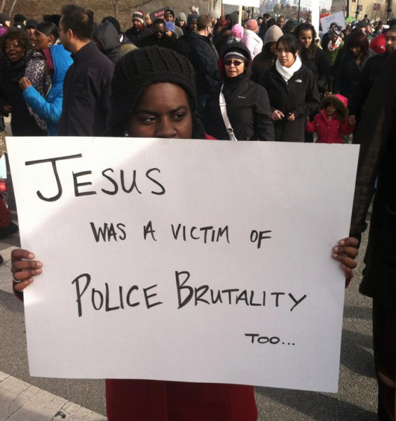"Black woman with sign ""Jesus was a victim of police brutality too..."""