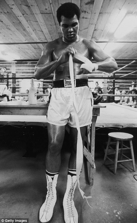 At a gym in Deer Lake, Pennsylvania in 1975, Ali wraps his hands before a session