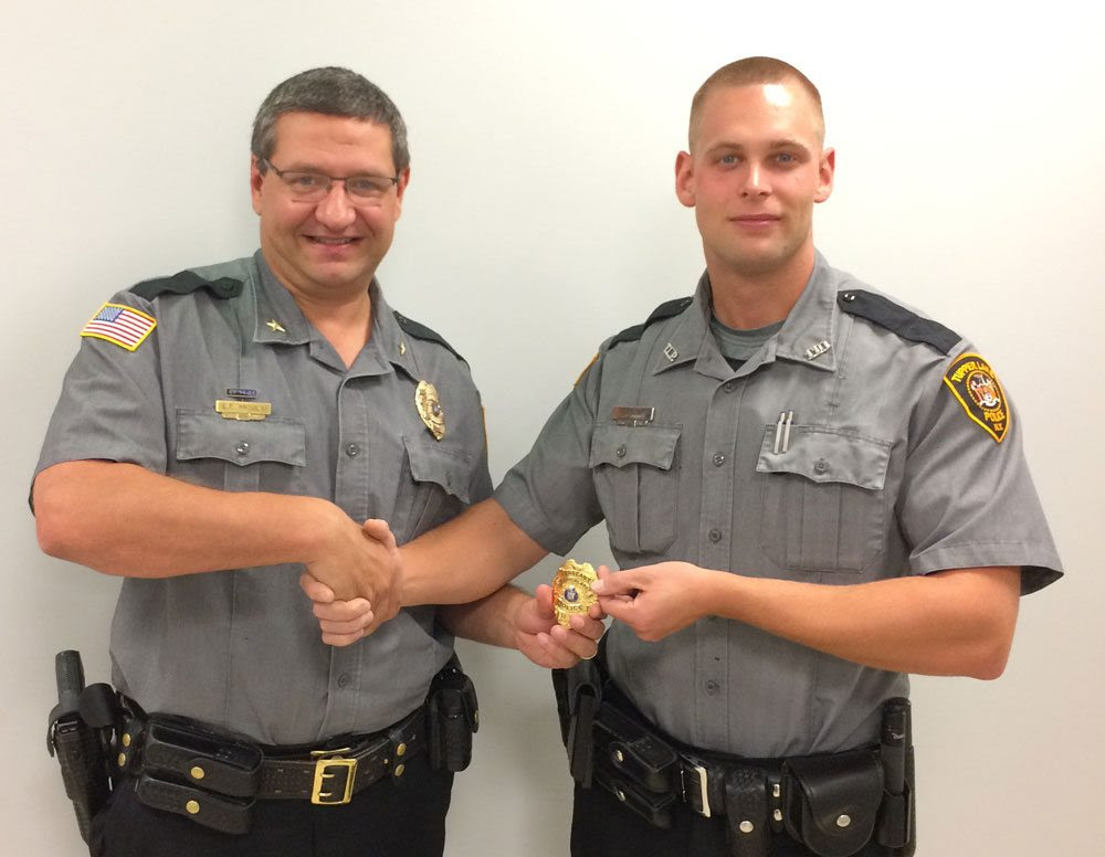Tupper Lake village police Sgt. Matthew Dana, right, shakes hands with Chief of Police Eric Proulx in September 2016 as Dana is promoted to sergeant on Proulx's recommendation. (Photo provided)