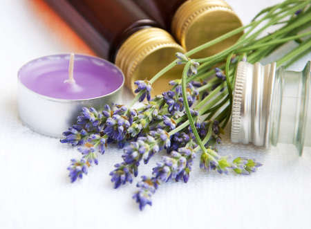 Bottles Of Essential Oil, Candle And Lavender Flowers Royalty Free ...