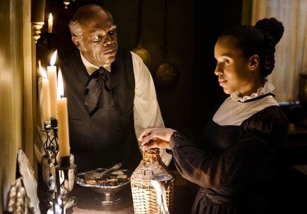Stephen (Samuel L. Jackson) tries to prevent Broomhilda (Kerry Washington) from reuniting with Django in DJANGO UNCHAINED.
