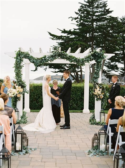 Elegant outdoor wedding ceremony with lanterns on the