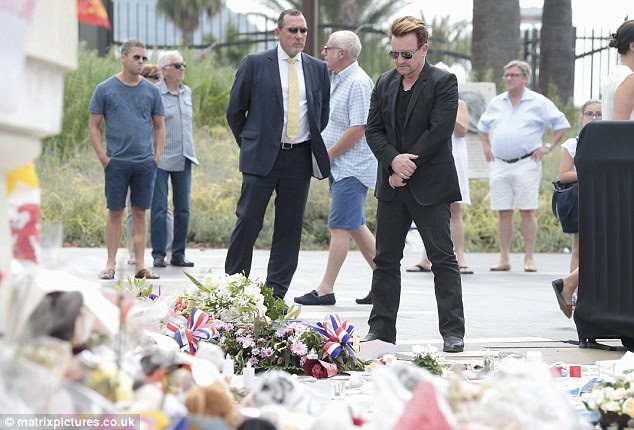 Bono, 56, looked emotional after he laid a bouquet of flowers at the scene where at least 84 people were killed by truck terrorist Mohamed Lahouaiej Bouhlel