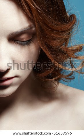 half-face portrait of redhead freckled girl