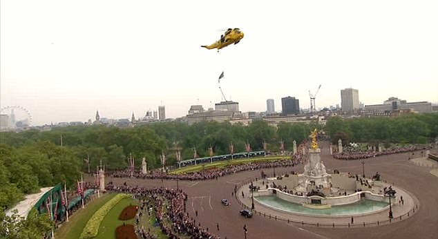 Salute to their friend: A Sea King helicopter hovers above the Victoria Memorial as Prince William drives his wife in the Aston Martin to Clarence House