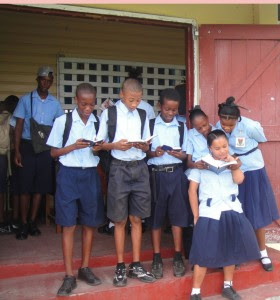 While prayer has not been part of school life for  several years, yesterday these students were seen reading  their bibles on the East Ruimveldt Secondary school steps.