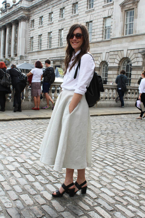 Claire wears: Skirt: H&M, Shirt: Cos, Backpack: Whistles, Shoes: & Other Stories, Shades: I Respect