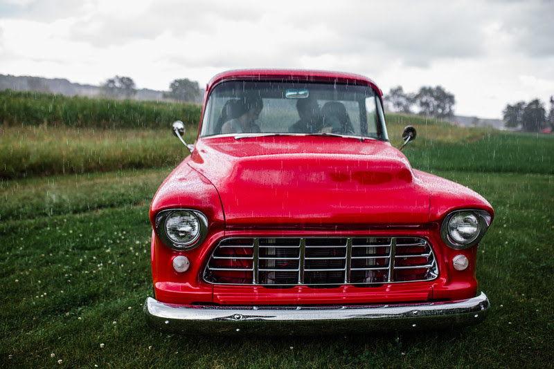 A first look with a vintage red truck for a wedding in Fort Atkinson Wisconsin about 30 minutes east of Madison and an hour north of Chicago. Photo by Mindy Joy Photography.