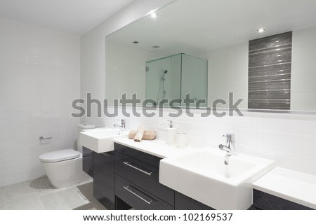 Modern Twin Bathroom With Sinks, Toilet And Shower. Stock Photo ...