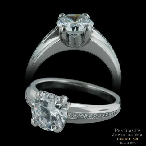 An exquisite platinum Gramercy engagement ring with pave d..