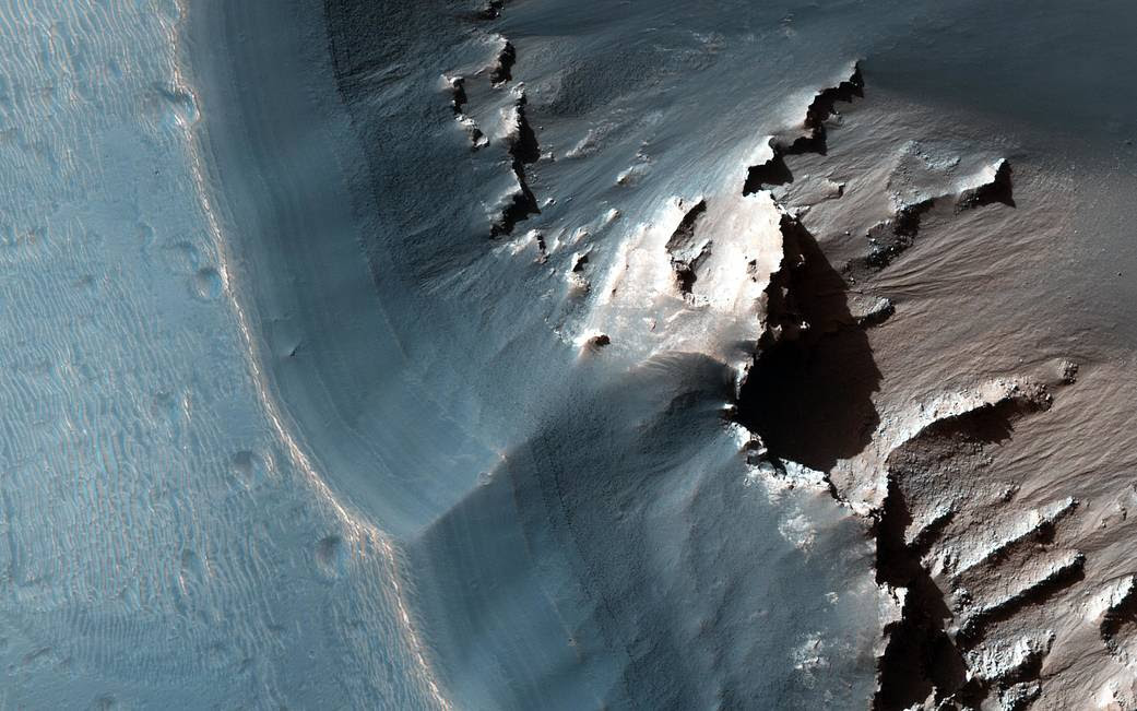Light toned layered pit depression on surface of Mars
