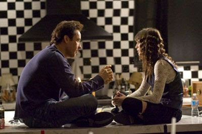 John Cusack and Lizzy Caplan share a moment in HOT TUB TIME MACHINE.