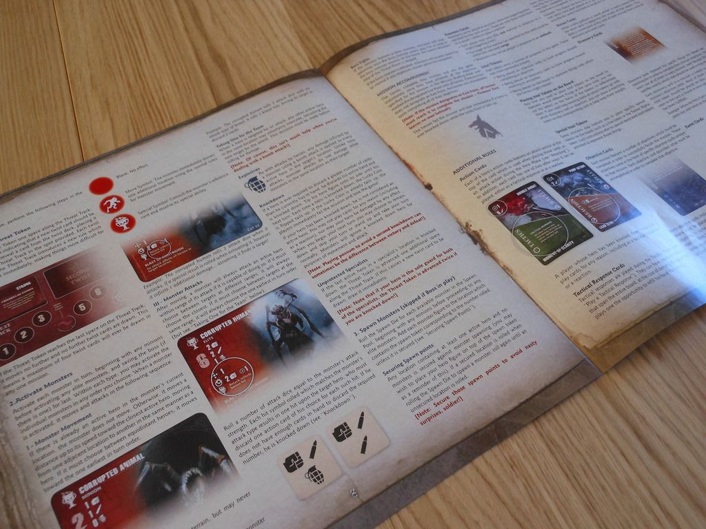 Shot of inside pages from the Fireteam Zero rules book, showing neatly arranged rules for monster activation.