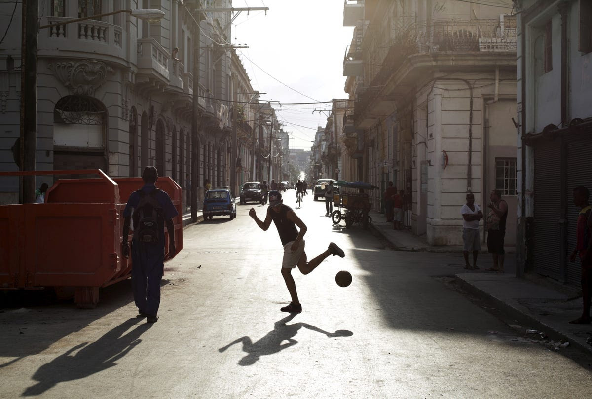 Soccer games are played everywhere, even in the street.