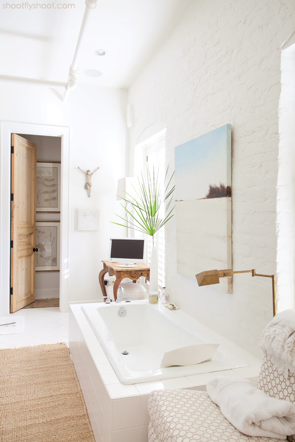Atchison Home | White Bathroom | Brick Wall