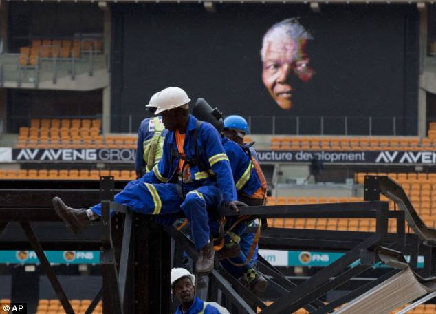 Work is carried out to put up a stage at the FNB stadium where his memorial service will open tomorrow with a rendition of the South Africa national anthem