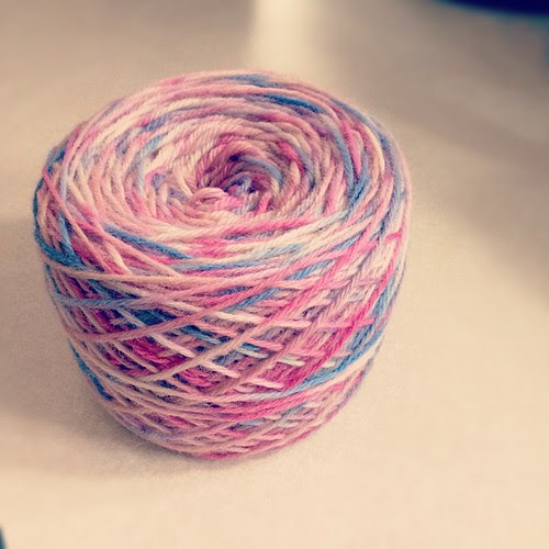 Pretty yarn cake about to become a tap dancing T-Rex! #yarn #knitting #rebeccadanger