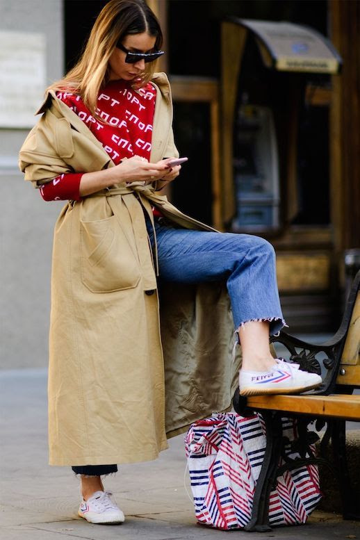 Le Fashion Blog Tbilisi Fashion Week Sunglasses Red Sweatshirt Trench Coat Raw Hem Jeans Sneakers Via Harpers Bazaar