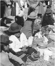Market in the Sacred Valley. In Peru's informal economic sector,  street vendors sell anything from food to flowers.