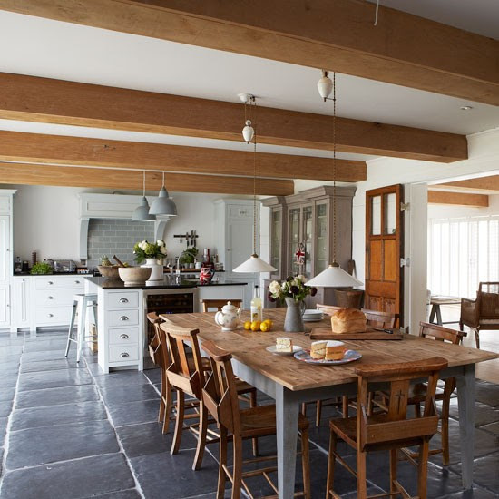 Farmhouse-style kitchen diner with large wooden dining table | West Sussex country house | House tour | PHOTO GALLERY | Country Homes and Interiors | Housetohome.co.uk