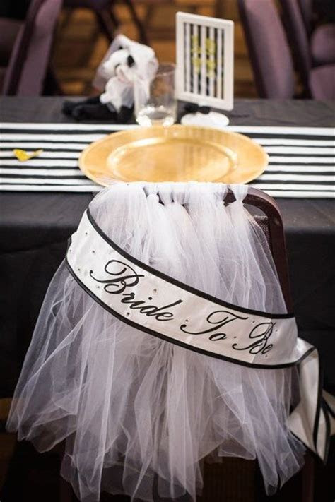 Adorn bride's chair at bridal shower with tulle resembling