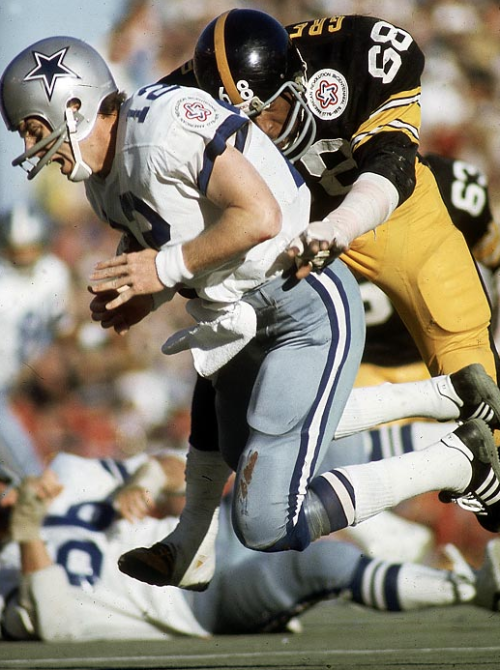 Roger Staubach being tackled by L.C. Greenwood (1976)