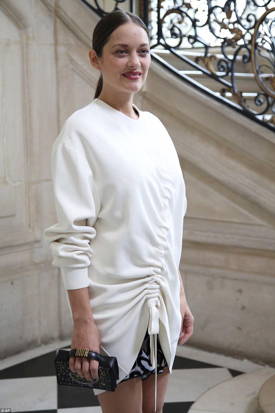 Stunning: She arrived in a stunning white top, which barely showed a hint of her baby bump
