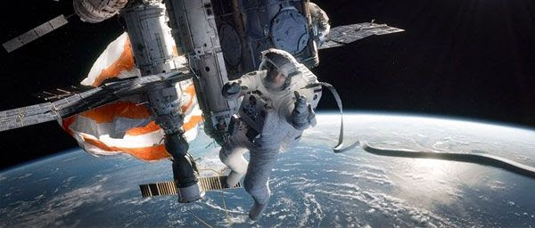 Mission Specialist Ryan Stone (Sandra Bullock) tries to seek refuge at the damaged International Space Station in GRAVITY.