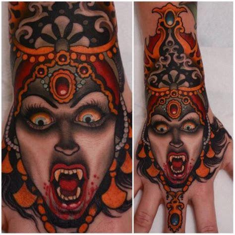 coloured school vampiress tattoo hand peter