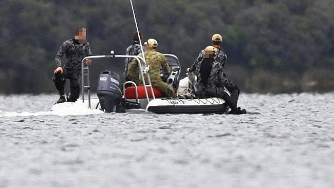 Police divers and soldiers on the scene at Australind, where a suspicious package has been found. Picture: Jordan Shields