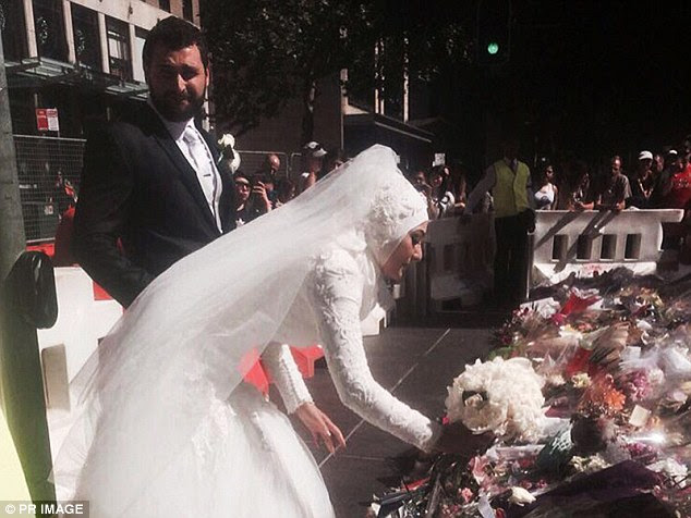 Newlywed Manal Kassem arrived at the memorial with her husband, Mahmod Homaisi, to place her wedding bouquet with the tens of thousands of other floral tributes in the square