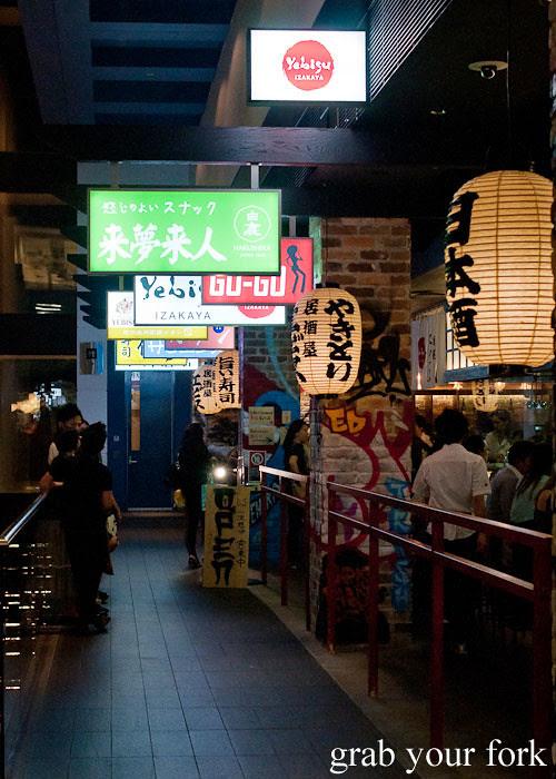 signs outside yebisu izakaya, regent place sydney