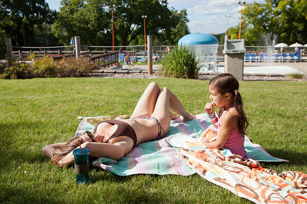 Teri & Freja Lutz sun & snack while at Mt Horeb pool.