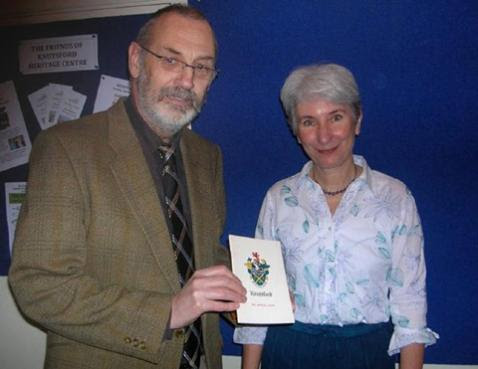 Martin Goldstraw with audience member Dorothy Webster looking at an old Knutsford guide book