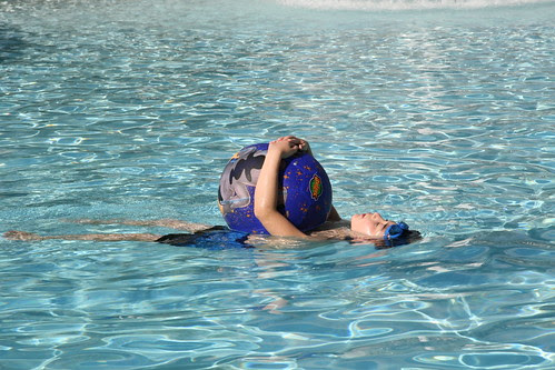 Adam floating with Stitch ball