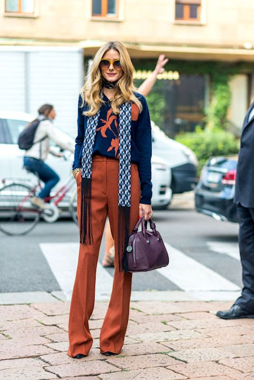 Le Fashion Blog Olivia Palermo Skinny Scarf Navy Blouse Burnt Orange Trousers Maroon Bag Via Harpers Bazaar