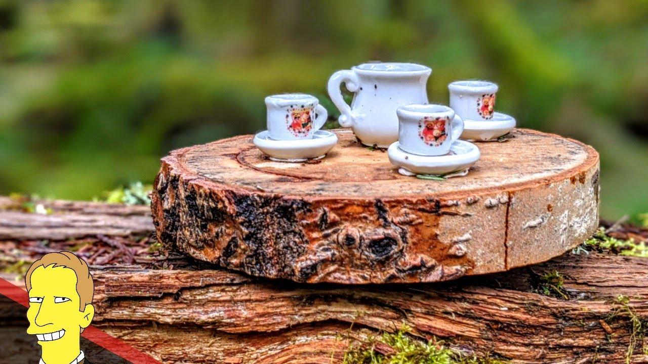 miniature china tea set sitting on top of a stump at Tea Pot Hill
