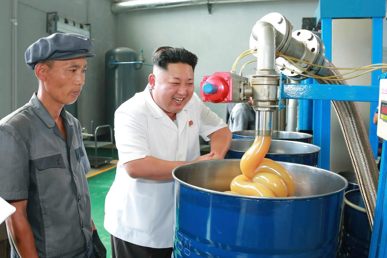 Image: KCNA picture shows North Korean leader Kim Jong Un smiling during a visit to the Chonji Lubricant Factory