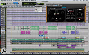 The Pro Tools Session for 'Getting Ready For Christmas Day'. The 10 topmost tracks are for Jim Oblon's muffled drum kit. Immediately beneath them, in green, is the sample of the sermon that inspired the song, and below that, Paul Simon's lead vocal. Apart from that, the main contributions are atremoloed acoustic guitar (light green) and an electric guitar, miked both at the amp and the strings.