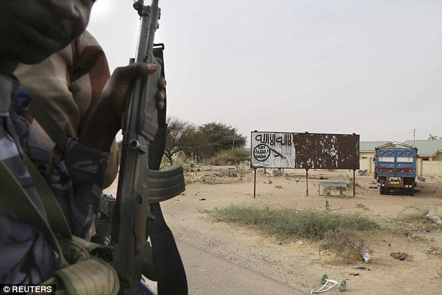Kidnapped: As many as 500 women and children were taken from Damasak, in north-eastern Nigeria, as Chadian troops (pictured) advanced on the town, which had been held by Boko Haram for months