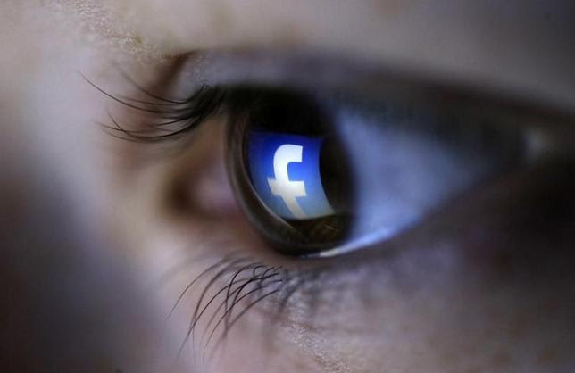 A picture illustration shows a Facebook logo reflected in a person's eye, in Zenica, March 13, 2015.   REUTERS/Dado Ruvic