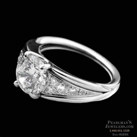 An exquisite platinum pave Empire engagement ring from Mic..