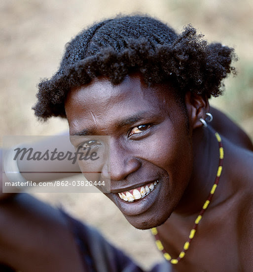 An unusual braided hairstyle of a Dassanech young man of the Omo River Delta.The Omo Delta of southwest Ethiopia is one of the least accessible and least developed parts of East Africa.As such, the culture, social organization, customs and values of the people have changed less than elsewhere. Stock Photo - Rights-Managed, Artist: AWL Images, Code: 862-03820444
